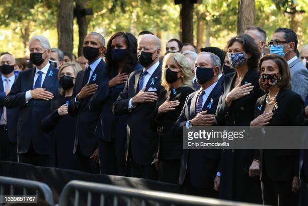 Former President Bill Clinton, former First Lady Hillary Clinton, former President Barack Obama, former First Lady Michelle Obama, President Joe...