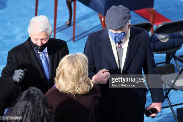 Former President Bill Clinton, former Secretary of State Hillary Clinton, and Sen. Patrick Leahy arrive to the inauguration of U.S. President-elect...