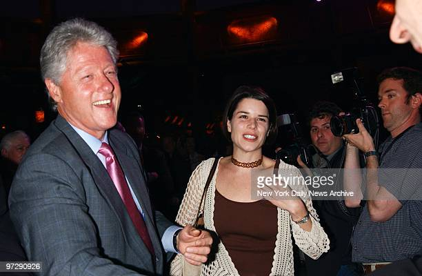Former President Bill Clinton gets together with actress Neve Campbell during a celebration of the Mohegan Sun casino's $1 billion expansion in...