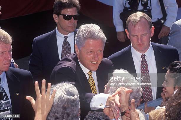 Former President Bill Clinton greets the crowd at a Santa Barbara City College campaign rally in 1996, Santa Barbara, California