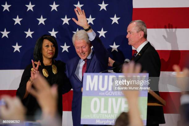 Former president Bill Clinton greets to attendees next Democratic candidate Phil Murphy who is running for the governor of New Jersey during a rally...