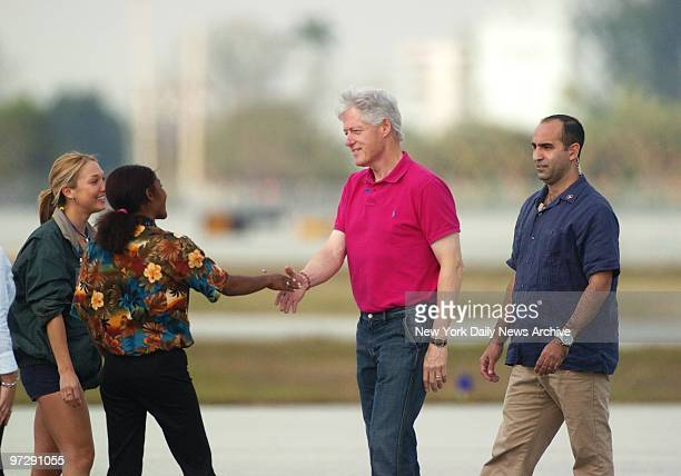Former President Bill Clinton greets wellwishers after getting off a plane at Palm Beach International Airport in West Palm Beach Fla Clinton's in...