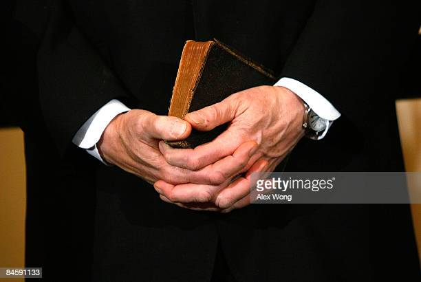 Former President Bill Clinton holds a bible during the ceremonial swearingin for his wife Secretary of State Hillary Clinton at the State Department...