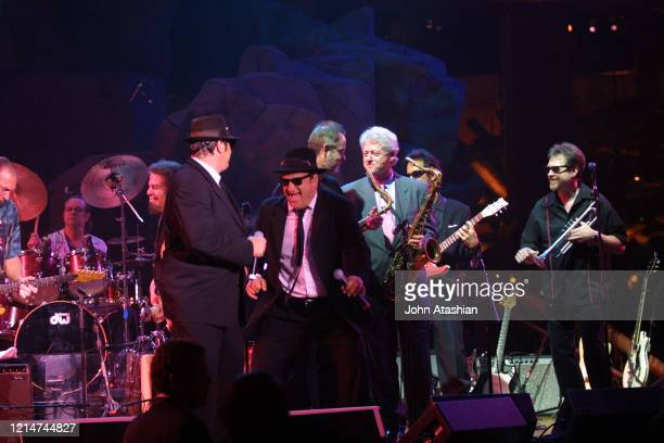 Former president Bill Clinton is shown performing with The Blues Brothers during a live concert appearance on June 21 2002