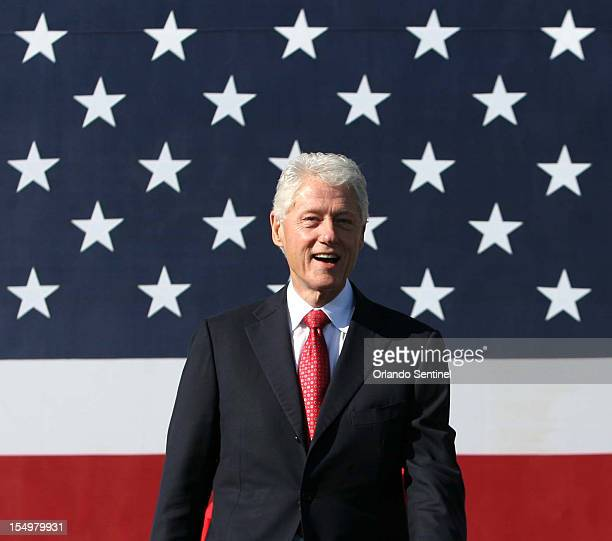Former President Bill Clinton is welcomed to the stage during a rally at the University of Central Florida Monday October 29 2012