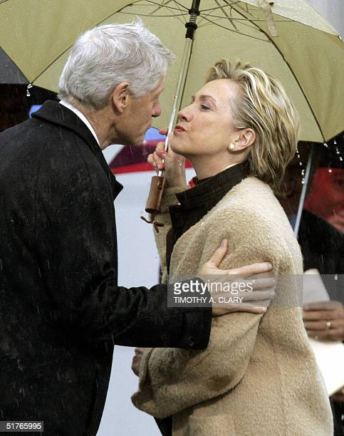 Former President Bill Clinton kisses his wife Senator Hillary Clinton after she introduces him at the dedication and opening of the William J Clinton...