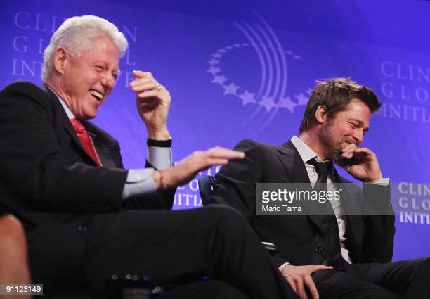 Former President Bill Clinton laughs with actor Brad Pitt while discussing postKatrina New Orleans at the Clinton Global Initiative September 24 2009...