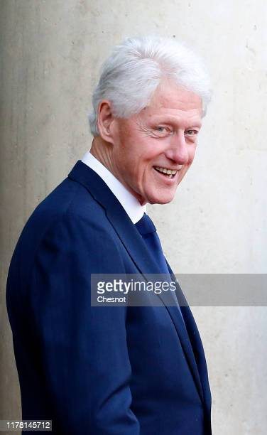 Former President Bill Clinton leaves after a lunch with leaders and heads of state, at the Elysee Presidential Palace on September 30, 2019 in Paris,...