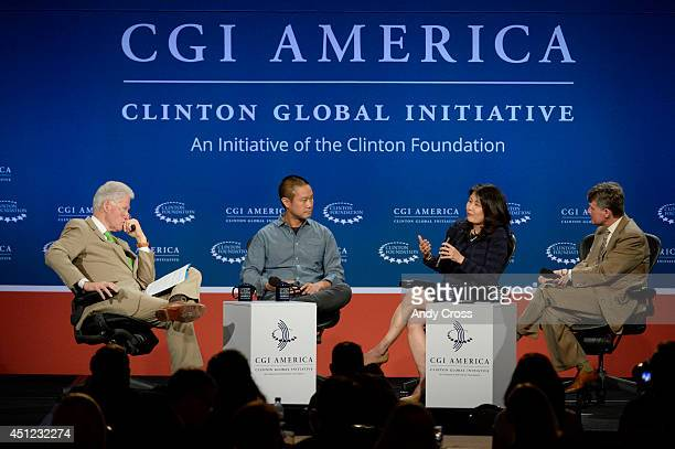 Former President Bill Clinton, left, moderates a panel discussion with Tony Hsieh, chief executive officer, Zappos.com, Audrey Choi, chief executive...