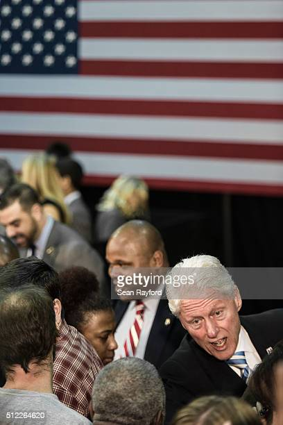 Former President Bill Clinton mingles with the crowd at Freedom Temple Ministry while campaigning for his wife, Democratic presidential candidate...
