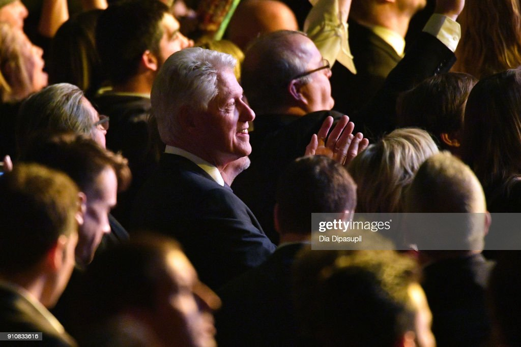 Former President Bill Clinton smiles while sitting in the audience during MusiCares Person of the Year honoring Fleetwood Mac at Radio City Music Hall on January 26, 2018 in New York City.