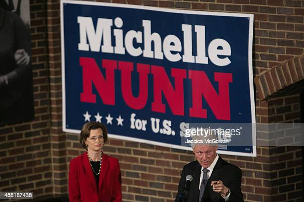 Former president Bill Clinton speaks at a campaign rally for Georgia Senate candidate Michelle Nunn at Paschal's on October 31, 2014 in Atlanta,...
