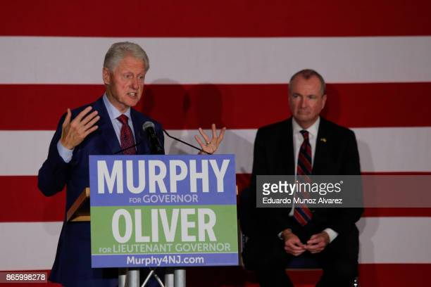 Former president Bill Clinton speaks next to Democratic candidate Phil Murphy who is running for the governor of New Jersey during a rally on October...
