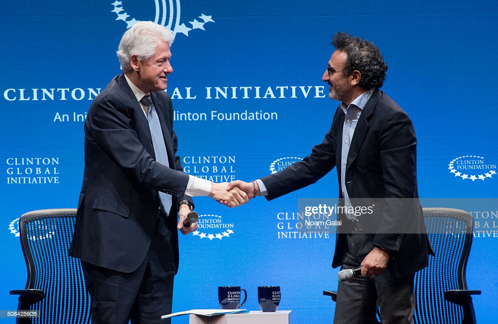 Former President Bill Clinton (L) speaks with founder of Tent Foundation Hamdi Ulukaya at The Clinton Global Initiative Winter Meeting at Sheraton New York Times Square on February 4, 2016 in New York City.