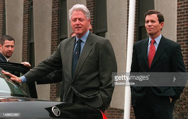 Former president Bill Clinton stops to answer questions from members of the media on Wednesday outside of the Mass Envelope Plus company in...