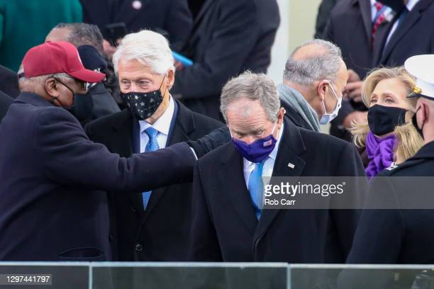 Former President Bill Clinton talks with Rep. Jim Clyburn as former U.S. President George W. Bush and Hillary Clinton arrive at the inauguration of...
