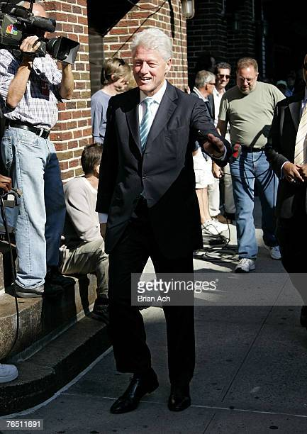 """Former President Bill Clinton visits """"The Late Show with David Letterman"""" on September 4 at the Ed Sullivan Theatre in New York City."""