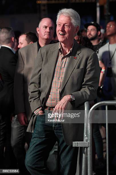 Former President Bill Clinton watches Chance the Rapper's set during the 2016 Budweiser Made in America Festival at Benjamin Franklin Parkway on...