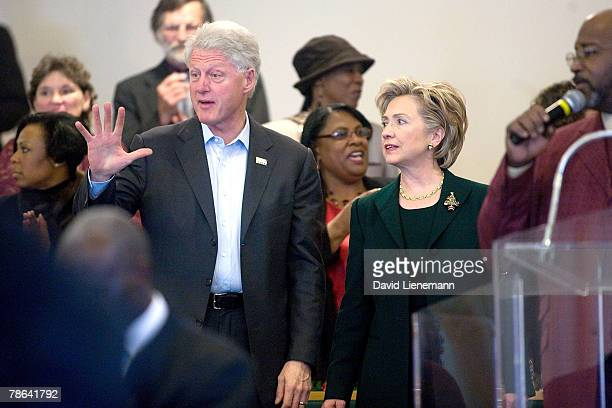 Former president Bill Clinton waves goodbye with his wife Democratic presidential hopeful Hillary Clinton after services at Mt Carmel Baptist Church...