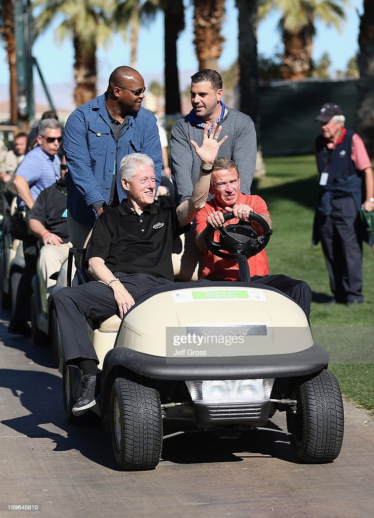 Former President, Bill Clinton, waves to fans, as he's driven around the course by PGA TOUR Commissioner Tim Finchem during the first round of the Humana Challenge In Partnership With The Clinton Foundationat at the Palmer Private Course at PGA West on January 17, 2013 in La Quinta, California.