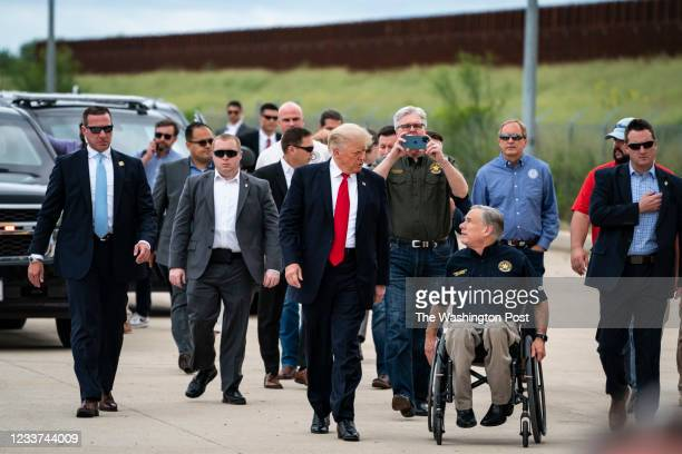 Former President Donald J. Trump and Texas Governor Greg Abbott arrive to speak during a tour of the US-Mexico border wall on Wednesday, June 30,...