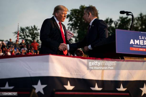 Former President Donald J. Trump speaks with Republican congressional candidate Mike Carey at a rally at the Lorain County Fairgrounds on Saturday,...