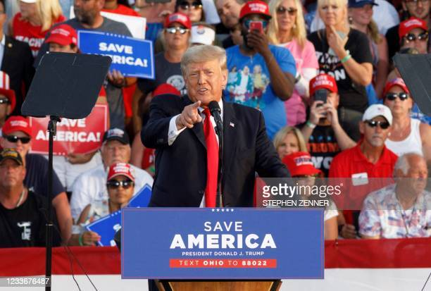 """Former President Donald Trump points at the press box speaks of """"Fake News"""" during his campaign-style rally in Wellington, Ohio, on June 26, 2021. -..."""