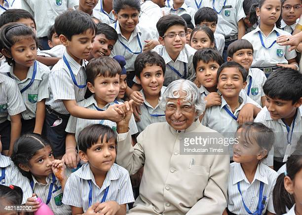 Former President Dr APJ Abdul Kalam posing with the children of Millennium School on October 7 2010 in Lucknow India He addressed the students and...
