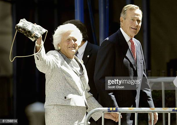 Former President George Bush and his wife Barbara walk toward the Church of Our Saviour Catholic church in September 2, 2004 in New York City. The...
