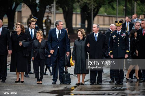 Former president George Bush, former first lady Laura Bush and members of the Bush family wait for the start of a ceremony for former President...