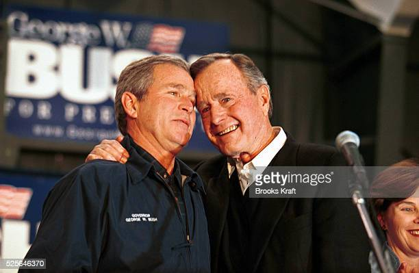 Former President George Bush hugs his son George W Bush in a show of paternal support for Bush Jr's presidential campaign Texas Governor George W...