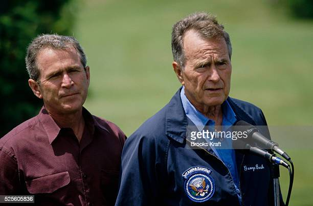 Former president George Bush Sr and his son George W Bush speak to the press in Kennebunkport Maine This June 13 press conference is early in George...