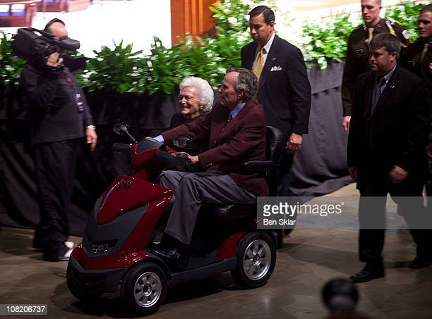 Former President George H W Bush and first lady Barbara Bush leave after a panel discussion at an event honoring the 20th anniversary of the Persian...