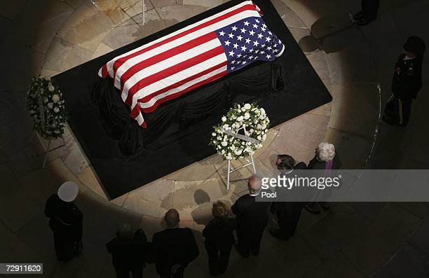 Former President George H W Bush and former first lady Barbara Bush pay their respects as the remains of President Gerald Ford lie in state at the US...