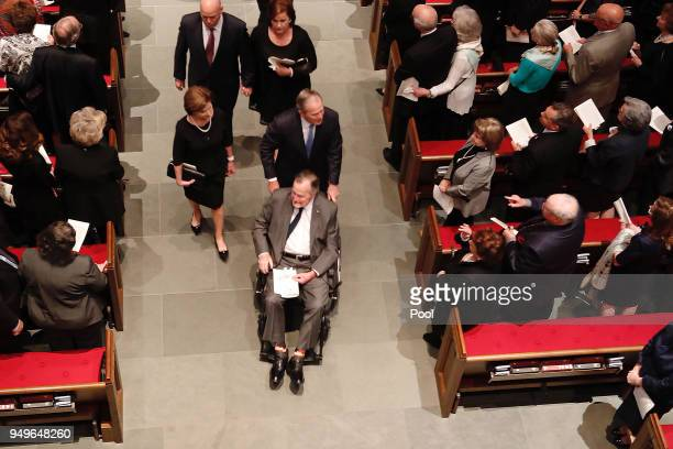 Former President George H W Bush former president George W Bush and former first lady Laura Bush prepare to exit St Martin's Episcopal Church after...