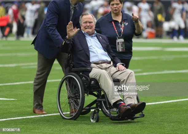 Former President George H W Bush participated in the coin toss before the football game between the Indianapolis Colts and Houston Texans at NRG...
