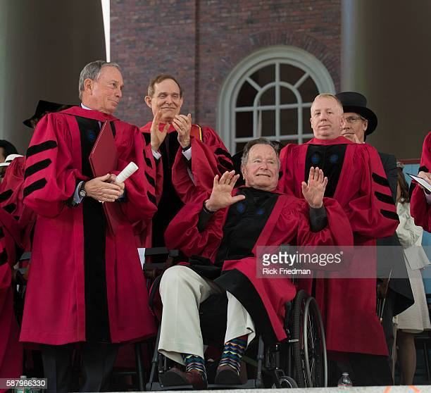 Former President George H W Bush receives a standing ovation as he receives an honorary Doctor of Laws degree during Harvard University's...
