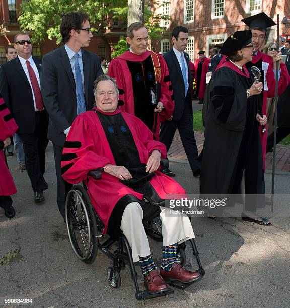 Former President George H W Bush receives an honorary doctorate during Harvard University's 363rd commencement ceremony in Cambridge MA on May 29 2014