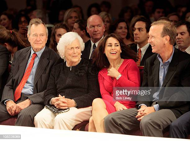 Former President George HW Bush along with wife Barbara Bush sit on the front row with their son Neil Bush and his wife Maria Bush as they await for...