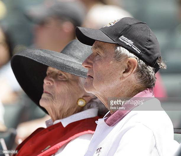 Former President George HW Bush and Barbara Bush attend a baseball game between the Pittsburgh Pirates and the Houston Astros at Minute Maid Park on...
