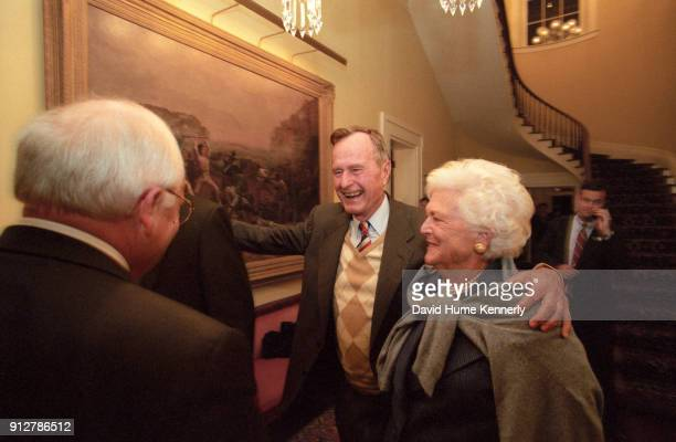 Former President George HW Bush and Barbara Bush greet Vice Presidential candidate Dick Cheney at the Texas Governor's Mansion on election night...