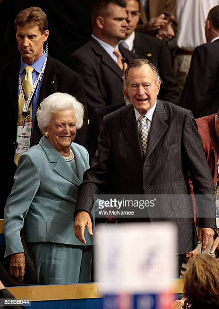Former President George H.W. Bush and former first lady Barbara Bush take their seats on day two of the Republican National Convention at the Xcel...