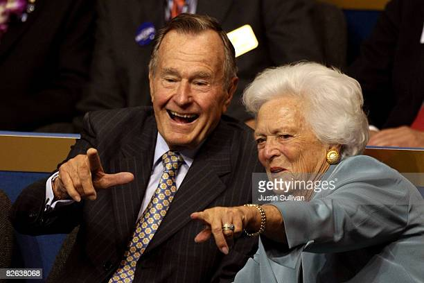 Former President George H.W. Bush and former first lady Barbara Bush point from their seats on day two of the Republican National Convention at the...