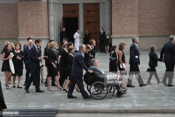 Former president George HW Bush and son former president George W Bush and family leave St Martin's Episcopal Church following the funeral service...