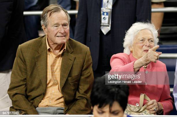 Former President George HW Bush and wife Barbara take their seats before the VCUButler game of the men's NCAA Final Four semifinal basketball game in...