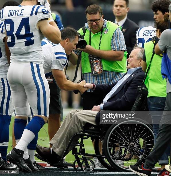 Former President George HW Bush at NRG Stadium shakes hands with Adam Vinatieri of the Indianapolis Colts before the coin toss on Salute to Services...