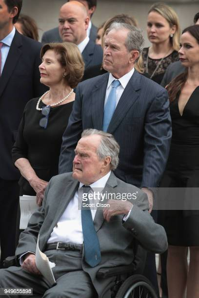 Former president George HW Bush former president George W Bush former first lady Laura Bush and family watch as the coffin of former first lady...