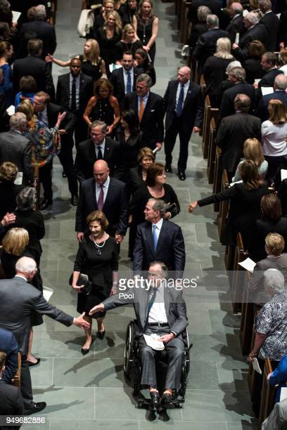 Former president George HW Bush former president George W Bush former first lady Laura Bush and family leave St Martin's Episcopal Church following...