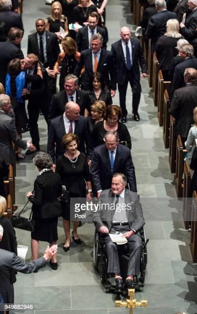 Former president George HW Bush former president George W Bush former first lady Laura Bush and family leave St Martin's Episcopal Church following...