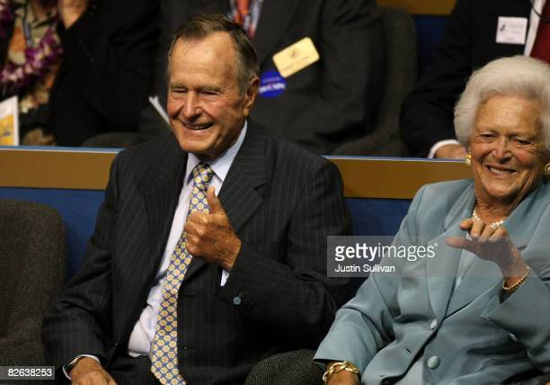 Former President George H.W. Bush gives the thumbs up and former first lady Barbara Bush waves on day two of the Republican National Convention at...
